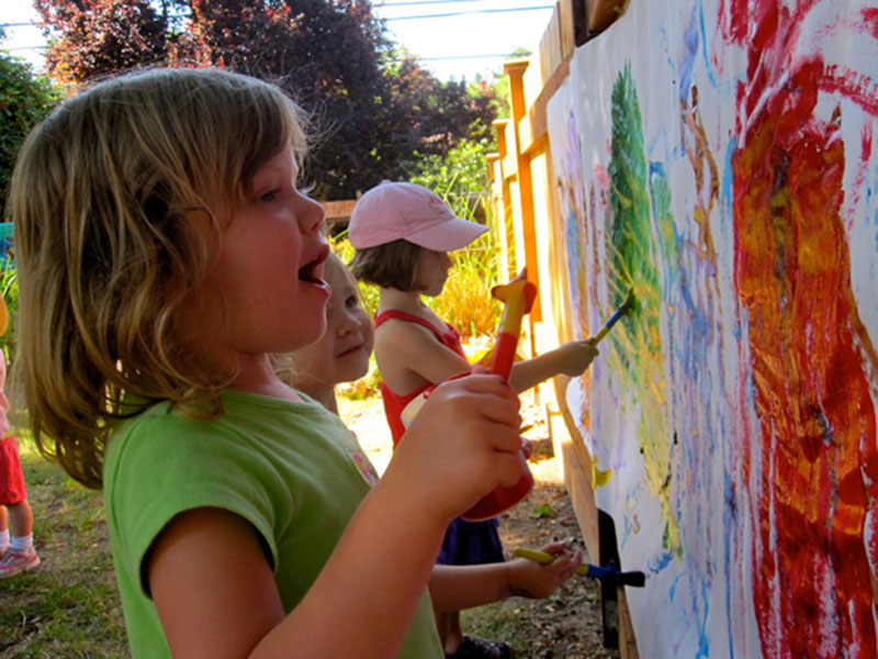children painting outside